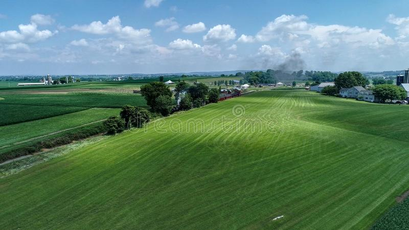 Aerial View of a Steam Train Arriving in Amish Countryside royalty free stock photo