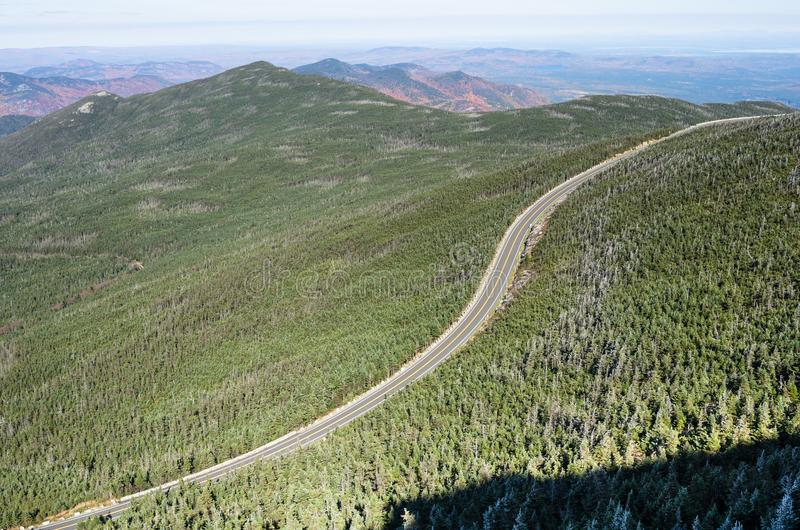 Winding Road in a Mountain Landscape on a Cold Sunny Autumn Day. Aerial View of a Steep Winding Mountain Road Through a Forest on a Sunny Autumn Day. Whiteface stock photography