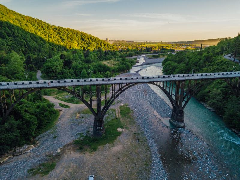 Aerial view of stone bridge over gorge of river Gumista, Abkhazia.  royalty free stock images