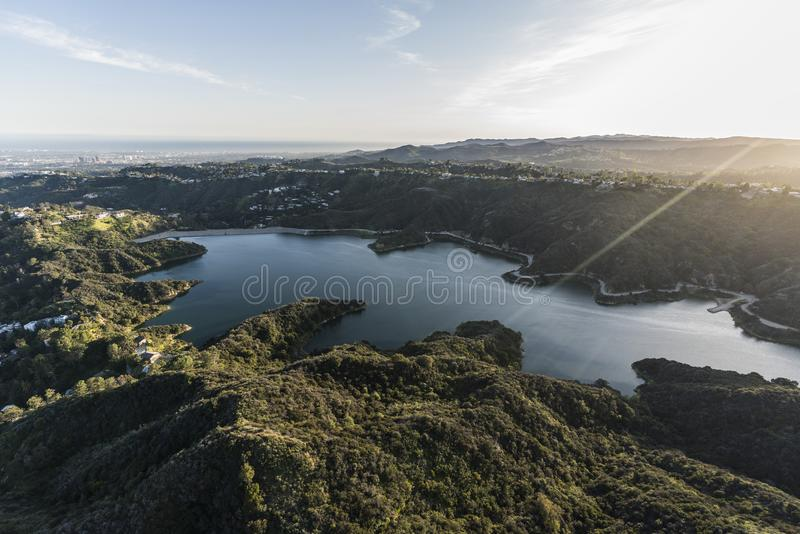 Stone Canyon Reservoir Aerial in Los Angeles California. Aerial view of Stone Canyon Reservoir and late afternoon sunshine with Los Angeles and pacific coast in stock photography