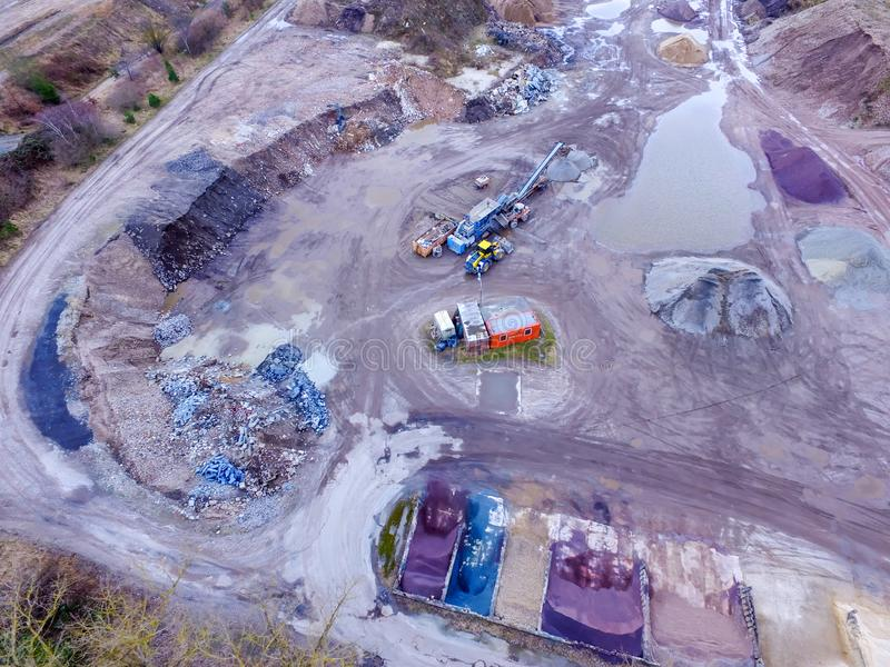 Aerial view of the storage area of a sand quarry with the storage areas for gravel, sand and recycling building materials stock image