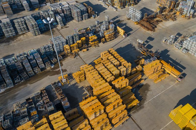 Aerial view of storage place. Construction materials in industrial city zone from above. Top view. Photo captured with drone royalty free stock photo