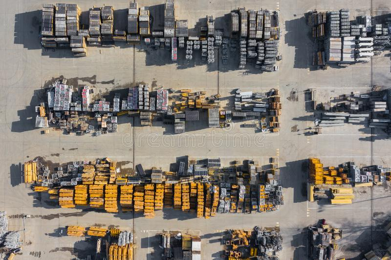 Aerial view of storage place. Construction materials in industrial city zone from above. Top view. Photo captured with drone stock images