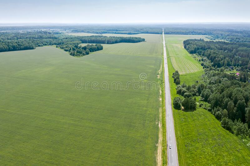 Aerial view of straight road in countryside stock images