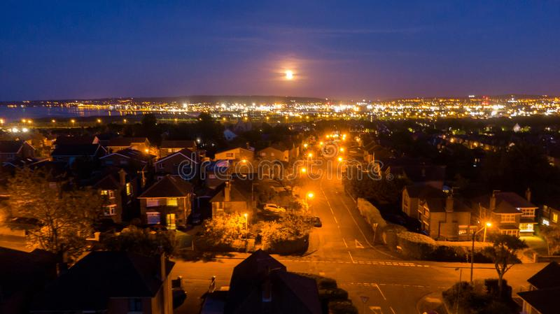 Aerial view on street and houses at night. Road Illuminated with street Lights royalty free stock photos