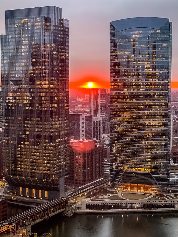 Aerial view of stunning ball of sun creating deep orange sunset over Chicago Loop royalty free stock images