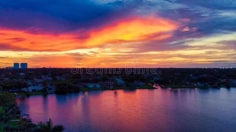 Aerial view on stunning dramatic sunset and lake at Sunrise City, Florida. stock photo