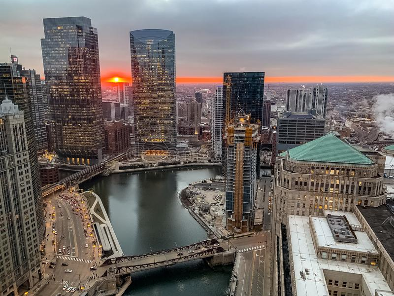 Aerial view of stunning orange ball of sun settig over Chicago`s horizon, seen from the Loop royalty free stock photo