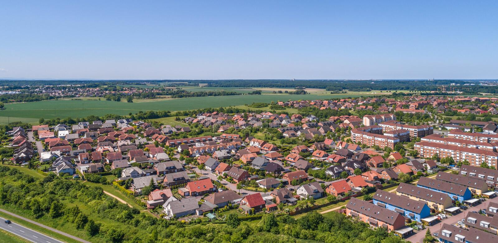 Aerial view of a suburb on the outskirts of Wolfsburg in Germany, with terraced houses, semi-detached houses and detached houses. Made with drone stock image