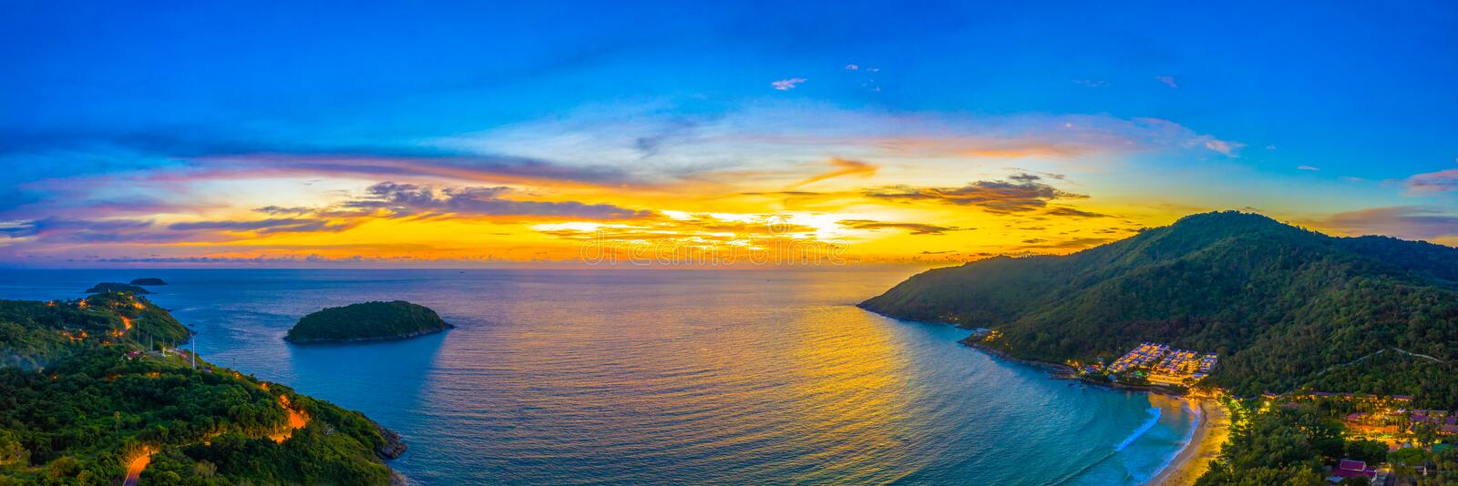 Aerial view sunset above Nai Harn beach. Nai Harn beach is a famouse landmark and popular sunset viewpoint of Phuket Thailand stock photography