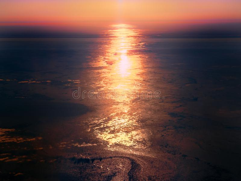 Sun reflecting off the icy surface of the Arctic Ocean. Aerial view of sunset over the Greenland Sea, between North Atlantic and Arctic oceans. Ice cover is royalty free stock photography