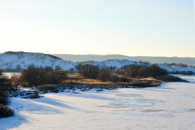 Aerial view of sunset over winter snow-covered river royalty free stock images