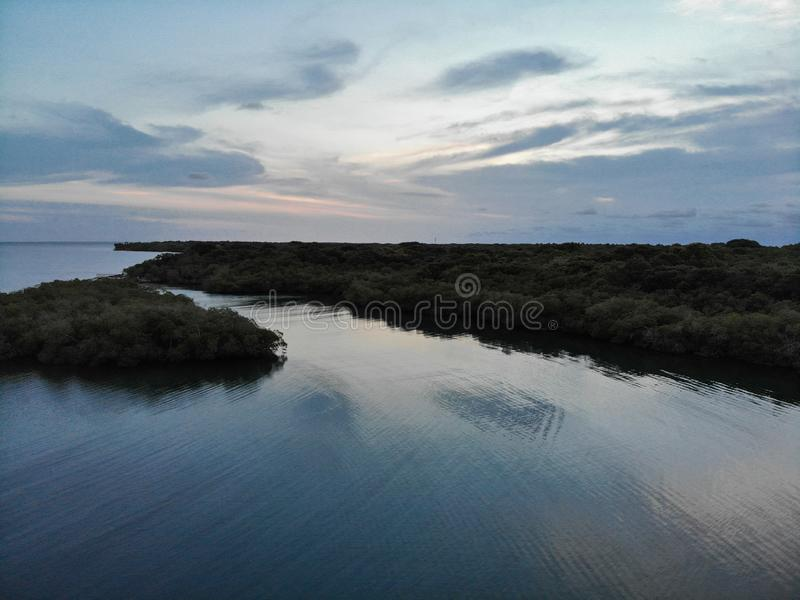 Aerial view of sunset reflection. Created by dji camera, greenery, greeb, forest, blue, sky, skies, cloud, clouds stock photo