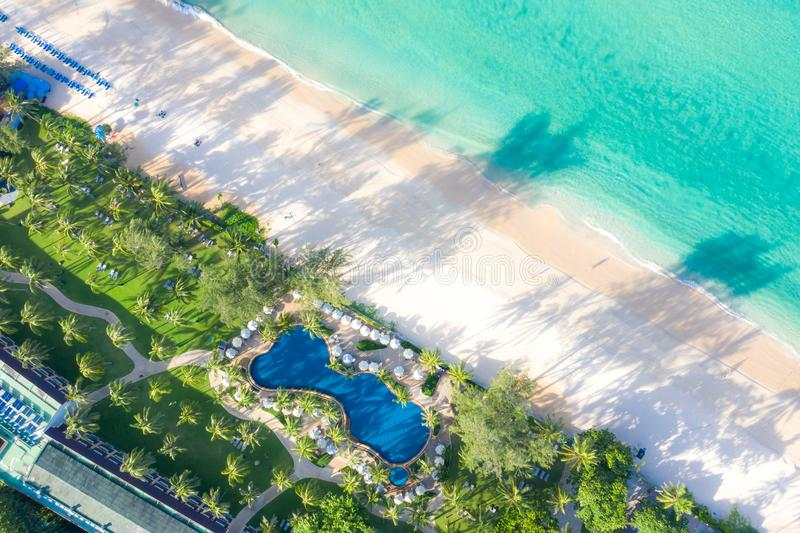 Aerial view of swimming pool with sea and beach in luxury hotel and resort for travel and vacation royalty free stock image