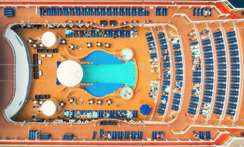 Aerial view of swimming pool, sunbeds, umbrellas on cruise ship royalty free stock image