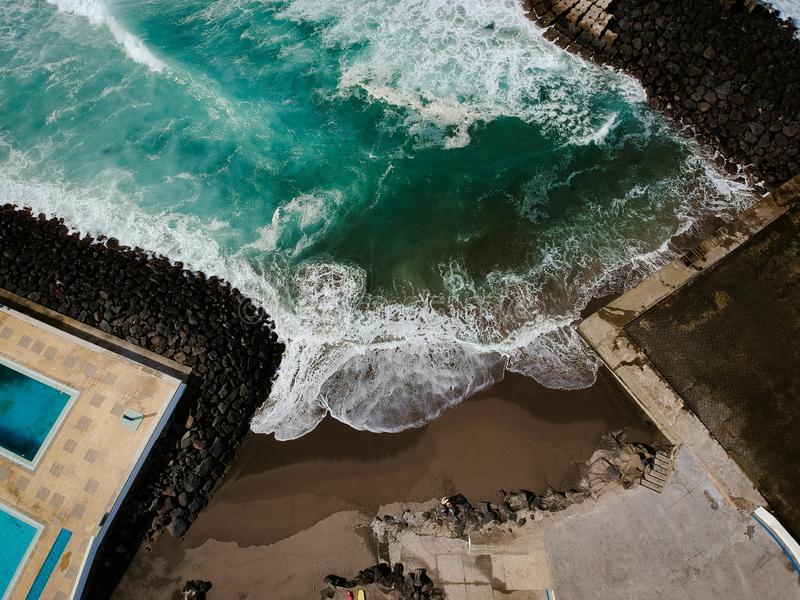 Aerial view from swimming pools near a beach. Drone shot. stock photo