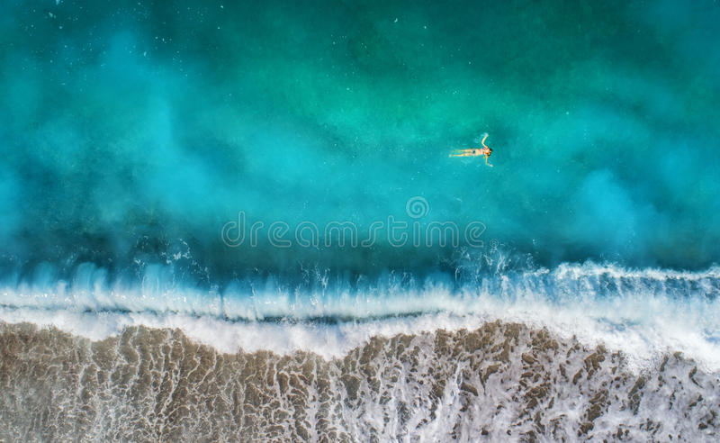 Aerial view of swimming woman in mediterranean sea royalty free stock photos