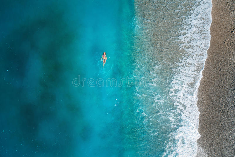 Aerial view of swimming woman in mediterranean sea stock images