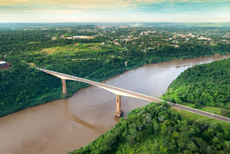 Aerial view of The Tancredo Neves Bridge, better known as Fraternity Bridge. Connecting Brazil and Argentina through the border over the Iguassu River, with the stock photography