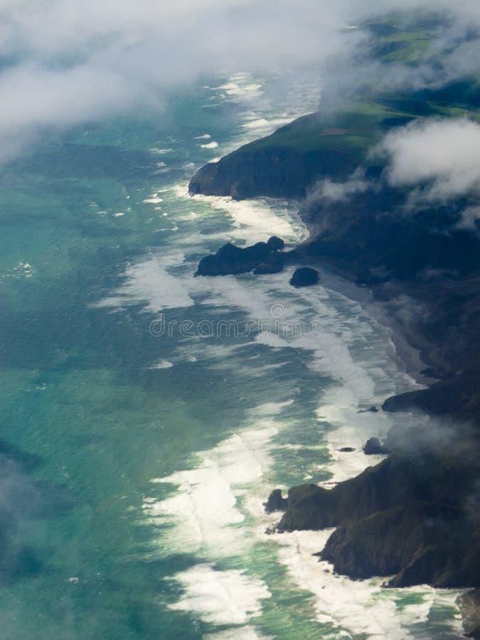 Aerial view of Tasman Sea shore NZ North Island. Aerial view of cliffs on New Zealand North Island west coast and Tasman Sea stock photo