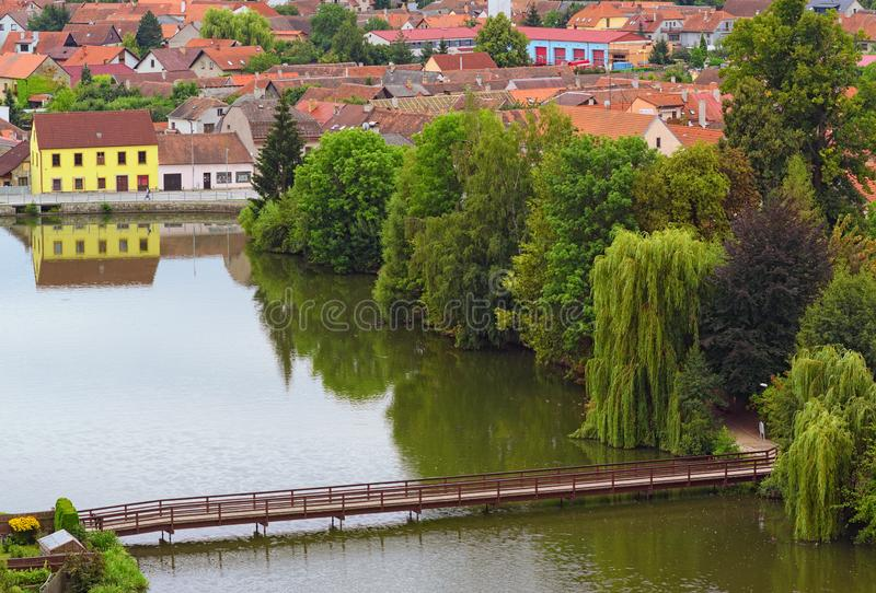 Aerial view of Telc and castle lake with wooden bridge. Summer landscape. Telc, Southern Moravia, Czech Republic royalty free stock image