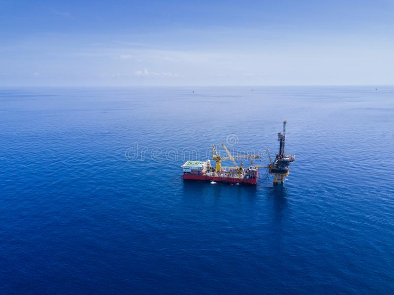 Aerial View of Tender Drilling Oil Rig Barge Oil Rig. In The Middle of The Ocean stock photos
