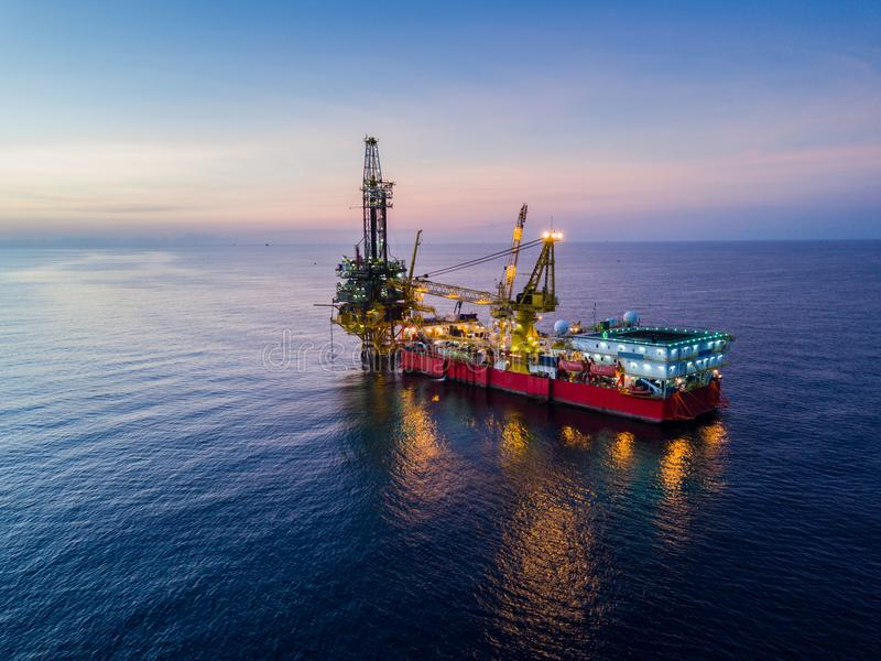 Aerial View of Tender Drilling Oil Rig Barge Oil Rig. In The Middle of The Ocean at Sunrise Time royalty free stock photos