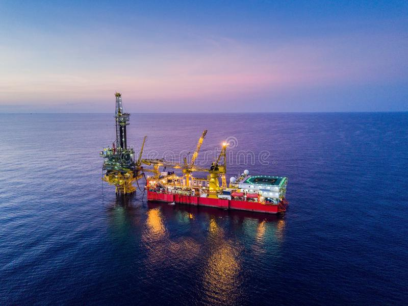 Aerial View of Tender Drilling Oil Rig Barge Oil Rig. In The Middle of The Ocean at Sunrise Time stock images