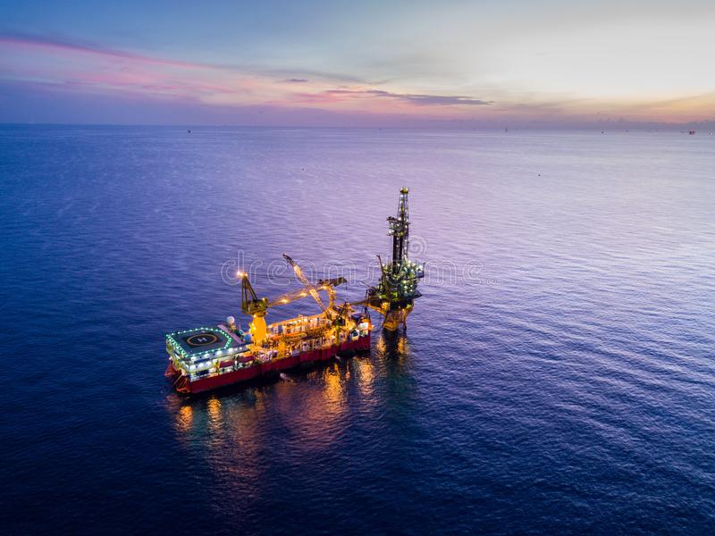 Aerial View of Tender Drilling Oil Rig Barge Oil Rig. In The Middle of The Ocean at Sunrise Time stock image
