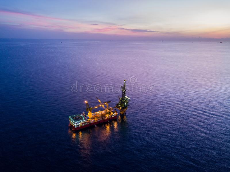 Aerial View of Tender Drilling Oil Rig Barge Oil Rig. In The Middle of The Ocean at Sunrise Time royalty free stock image