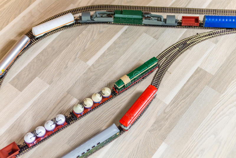 Aerial view on three model trains on wooden floor stock photography