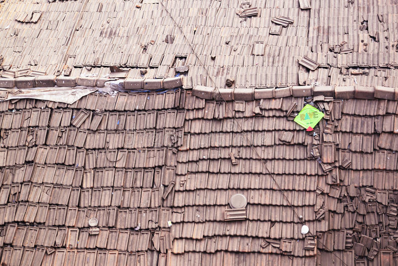 Aerial view of tiled roof. Rave is printed on kite. Horizontal shot of digital photography stock image