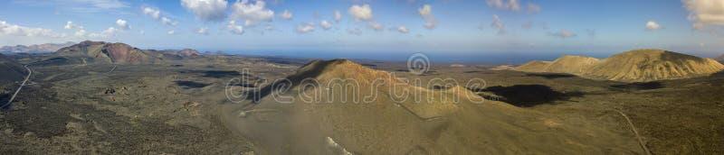 Aerial view of Timanfaya, national park, Caldera Blanca, panoramic view of volcanoes. Lanzarote, Canary Islands, Spain. Aerial view of Timanfaya, national park stock photography