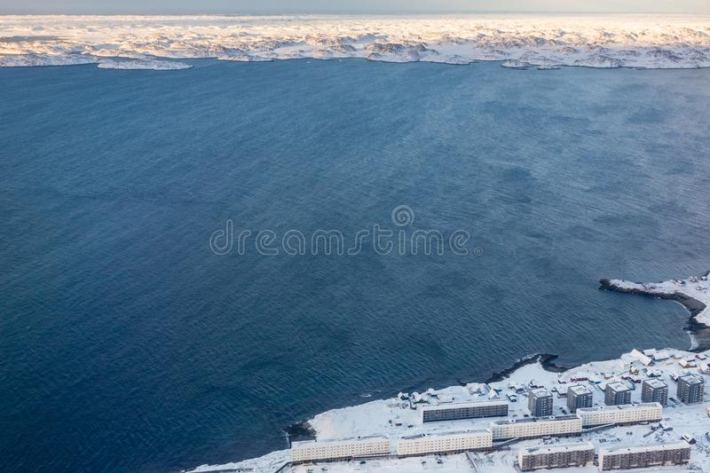 Aerial view to the fjord, Inuit houses and snow street of Greenlandic capital Nuuk city, Greenland stock photo
