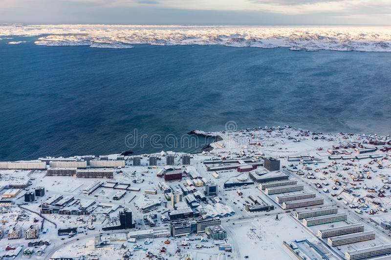 Aerial view to the fjord and snow streets of Greenlandic capital Nuuk city, Greenland stock photos