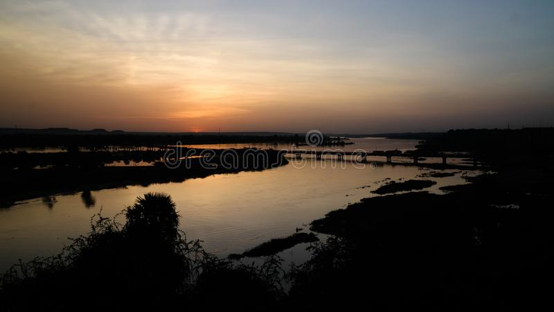 Aerial view to Niger river in Niamey at sunset Niger. Aerial view to Niger river in Niamey at sunset, Niger royalty free stock image