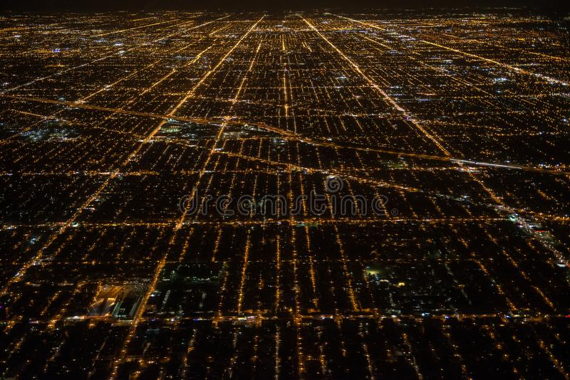 Aerial view to night city Chicago streets stock photos