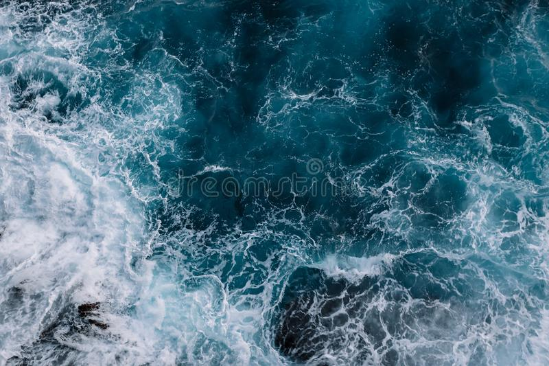 Aerial view to ocean waves. Water background royalty free stock images