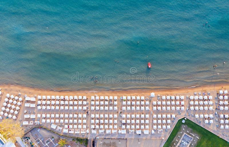 Aerial view to the popular Astir Beach in Vouliagmeni, Athens, Greece. With symmetrical placed sunbeds and umbrellas royalty free stock photo