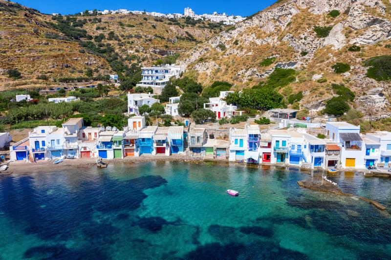 Aerial view to the syrmata fishing village Klima on the cylcadic island of Milos, Greece. Aerial view to the beautiful syrmata fishing village Klima on the stock photo