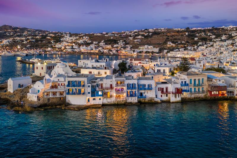 Aerial view to the town of Mykonos during sunset time, Cyclades, Greece. Aerial view to the town of Mykonos with the numerous bars and restaurants by the sea stock photos