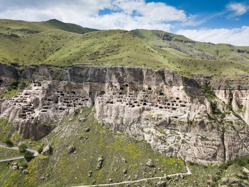 Aerial view to Vardzia cave monastery excavated from Erusheti Mountain on the left bank of the Mtkvari River, near Aspindza. Famous touristic place to Vardzia royalty free stock image