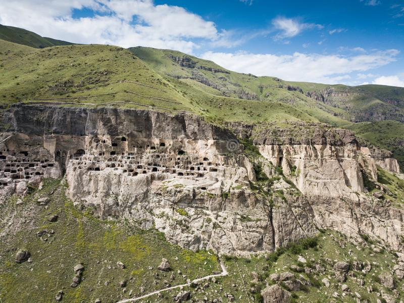 Aerial view to Vardzia cave monastery excavated from Erusheti Mountain on the left bank of the Mtkvari River, near Aspindza. Famous touristic place to Vardzia stock photography