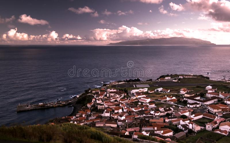 Aerial view to Vila do Corvo and Flores island at sunset, Corvo island, Azores, Portugal. Aerial view to Vila do Corvo and Flores island at sunset in Corvo stock images