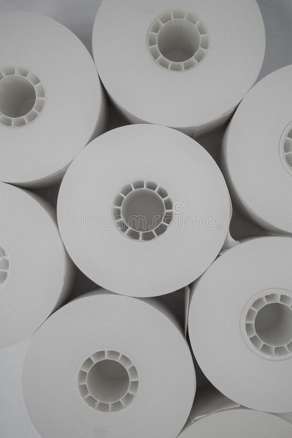 Black and white register tape rolls nestled together stock photos