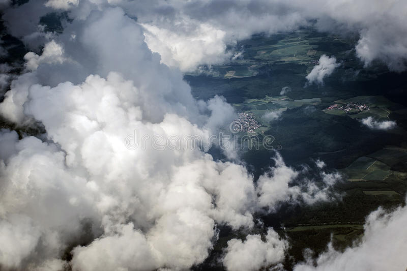 Aerial view Top cumulus clouds high over land. Aerial view Top cumulus clouds flying high over land stock images
