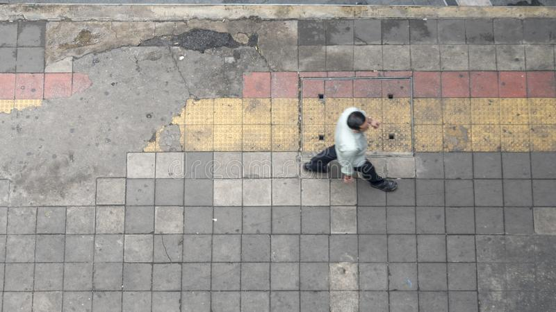 Aerial view and top view with blur man walk in business area wit royalty free stock photo
