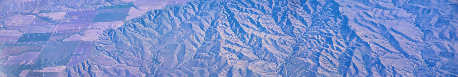 Aerial view of topographical landscapes over midwest states on flight over Colorado, Kansas, Missouri, Illinois, Indiana, Ohio an. D West Virginia during autumn stock photos