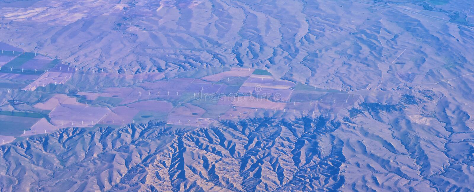 Aerial view of topographical landscapes over midwest states on flight over Colorado, Kansas, Missouri, Illinois, Indiana, Ohio an. D West Virginia during autumn royalty free stock photo
