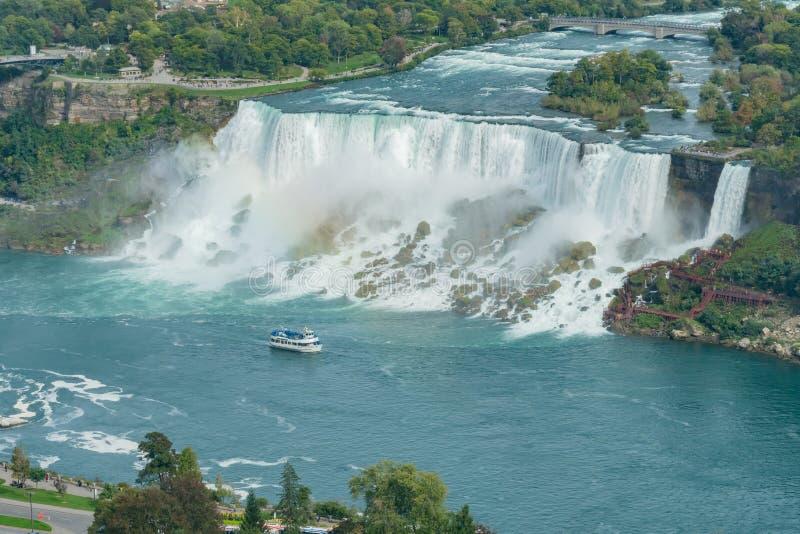 Aerial view of a tourist ship driving pass the beautiful Niagara Falls. At Canada stock photos